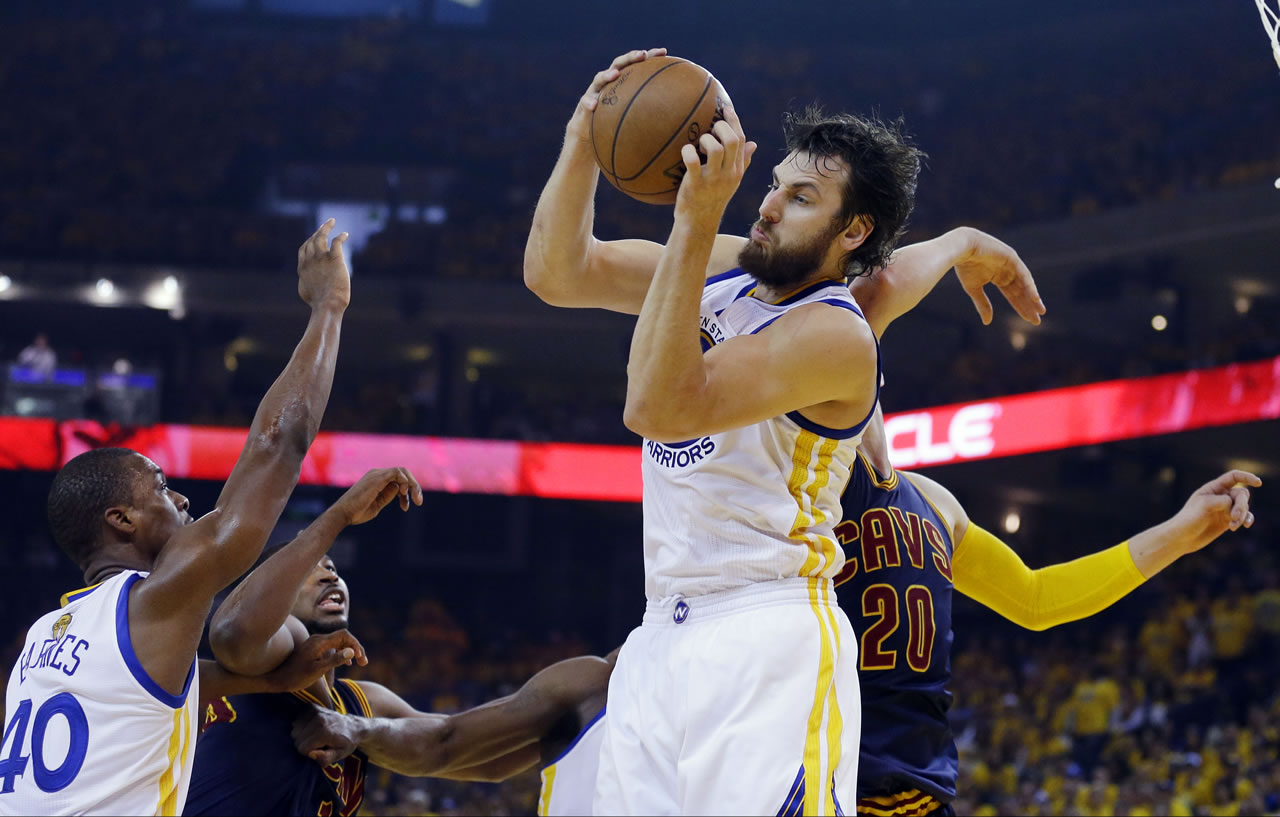 """<div class=""""meta image-caption""""><div class=""""origin-logo origin-image none""""><span>none</span></div><span class=""""caption-text"""">Warriors center Andrew Bogut grabs a rebound in front of Cavaliers center Timofey Mozgov during the first half of Game 1 of basketball's NBA Finals in Oakland, Calif., June 4, 2015 (AP Photo/Ben Margot)</span></div>"""
