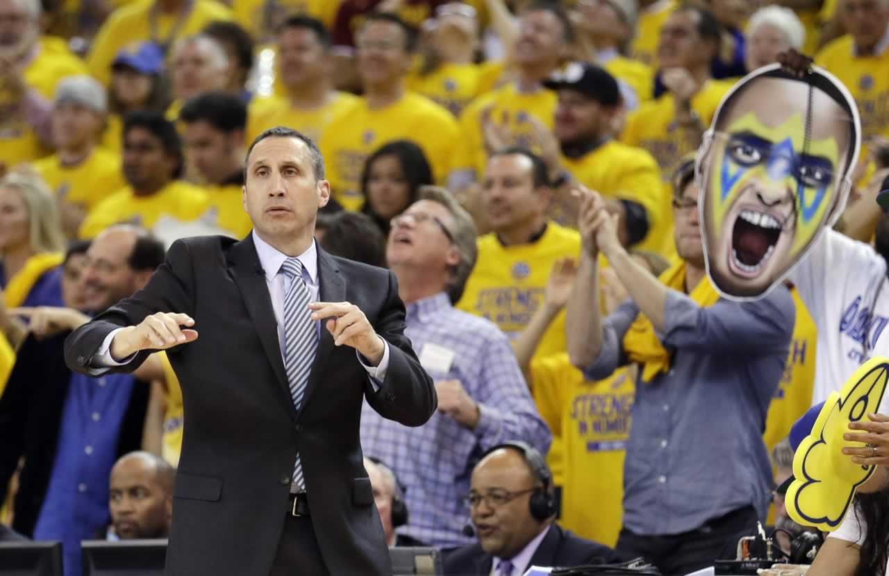 "<div class=""meta image-caption""><div class=""origin-logo origin-image none""><span>none</span></div><span class=""caption-text"">Cavaliers head coach David Blatt gestures as a fan holds up a large photo of Warriors guard Stephen Curry in Game 1 of basketball's NBA Finals in Oakland, Calif., Thursday, June 4, (AP Photo/Ben Margot)</span></div>"