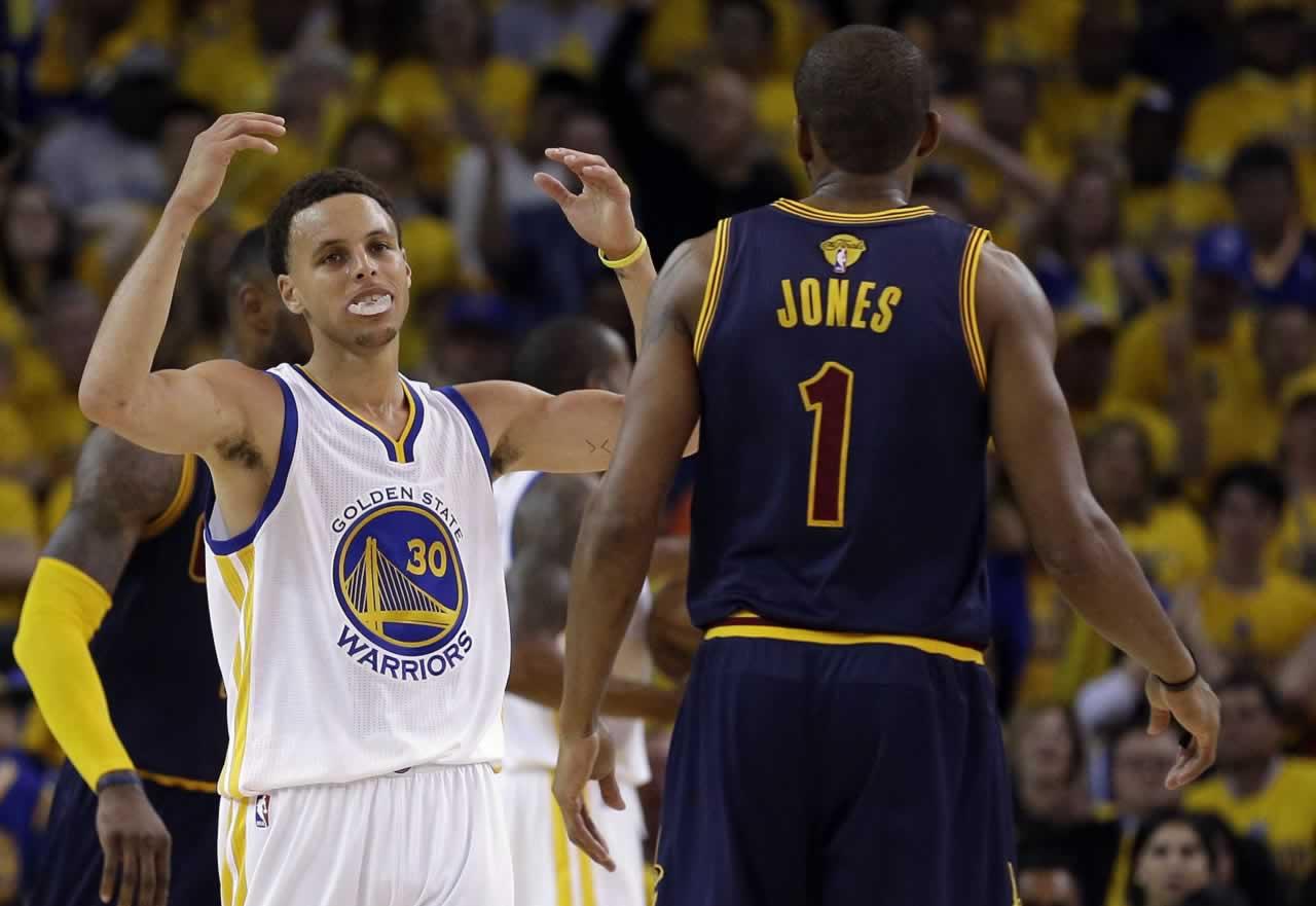 "<div class=""meta image-caption""><div class=""origin-logo origin-image none""><span>none</span></div><span class=""caption-text"">Warriors guard Stephen Curry reacts next to Cavaliers forward James Jones during Game 1 of basketball's NBA Finals in Oakland, Calif., Thursday, June 4, 2015. (AP Photo/Ben Margot)</span></div>"