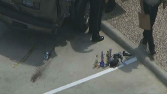 """<div class=""""meta image-caption""""><div class=""""origin-logo origin-image none""""><span>none</span></div><span class=""""caption-text"""">After apparent chase in Katy, officers removed a number of drug-related items and weapons from the suspect's vehicle. (KTRK Photo/ KTRK)</span></div>"""