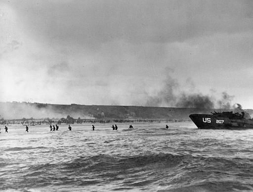 <div class='meta'><div class='origin-logo' data-origin='none'></div><span class='caption-text' data-credit='AP Photo/ PETER J. CARROLL'>Under the cover of naval shell fire, American infantrymen wade ashore from their landing craft during the initial Normandy landing operations in France, June 6, 1944.</span></div>