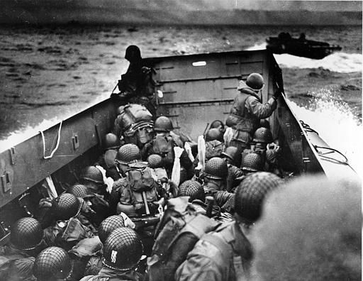 <div class='meta'><div class='origin-logo' data-origin='none'></div><span class='caption-text' data-credit='AP Photo/ ANONYMOUS'>A U.S. Coast Guard landing barge, tightly packed with helmeted soldiers, approaches the shore at Normandy, France, during initial Allied landing operations, June 6, 1944.</span></div>