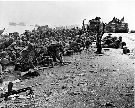 "<div class=""meta image-caption""><div class=""origin-logo origin-image none""><span>none</span></div><span class=""caption-text"">After landing at the shore, these British troops wait for the signal to move forward, during the initial Allied landing operations in Normandy, France, June 6, 1944. (AP Photo/ XCB)</span></div>"