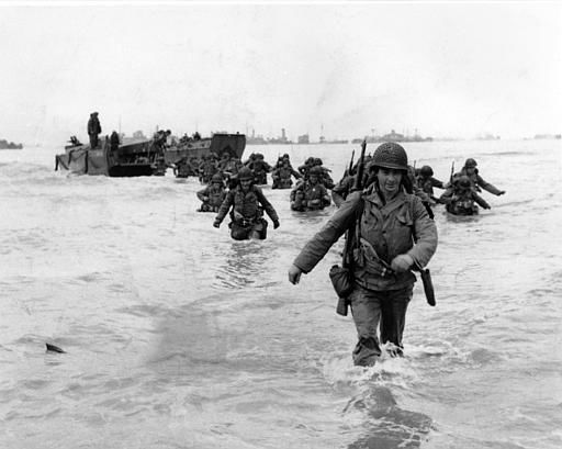 <div class='meta'><div class='origin-logo' data-origin='none'></div><span class='caption-text' data-credit='AP Photo/ BERT BRANDT'>U.S. infantrymen wade through the surf as they land at Normandy in the days following the Allies' June 1944, D-Day invasion of occupied France.</span></div>