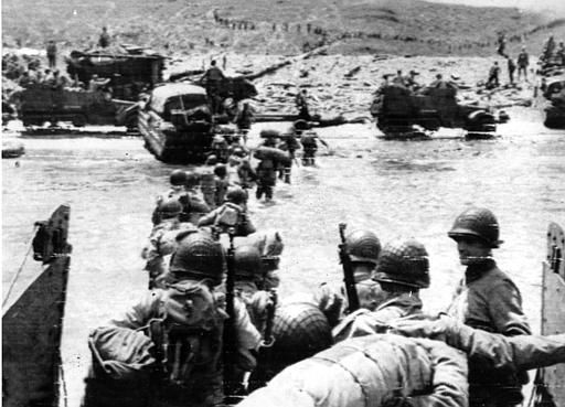 <div class='meta'><div class='origin-logo' data-origin='none'></div><span class='caption-text' data-credit='AP Photo/ XCJ AD'>Ducks (amphibious trucks) and a half-track follow foot troops ashore during the invasion of Normandy on a 100-mile front along the French coast by allied forces on June 6, 1944.</span></div>