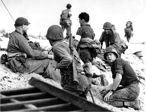 "<div class=""meta image-caption""><div class=""origin-logo origin-image none""><span>none</span></div><span class=""caption-text"">A first wave beach battalion Ducks lays low under the fire of Nazi guns on the beach of southern France on D-Day, June 6, 1944 during World War II. (AP Photo/ XCJ AD)</span></div>"