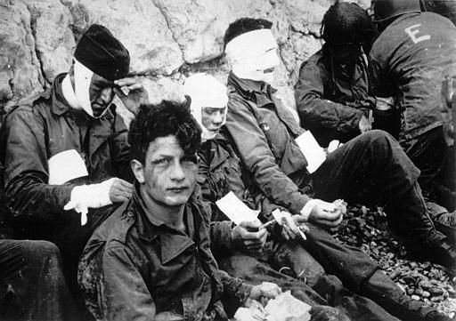 <div class='meta'><div class='origin-logo' data-origin='none'></div><span class='caption-text' data-credit='AP Photo/ XCB'>Men of the American assault troops of the 16th Infantry Regiment, injured while storming a coastal area code-named Omaha Beach during the Allied invasion of the Normandy.</span></div>