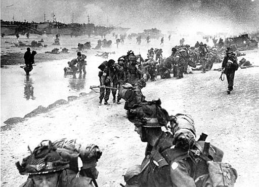 <div class='meta'><div class='origin-logo' data-origin='none'></div><span class='caption-text' data-credit='AP Photo/ ANONYMOUS'>Wounded British troops from the South Lancashire and Middlesex regiments are being helped ashore at Sword Beach.</span></div>