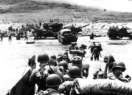 "<div class=""meta image-caption""><div class=""origin-logo origin-image none""><span>none</span></div><span class=""caption-text"">Ducks (amphibious trucks) and a half-track follow foot troops ashore during the World War II opening invasion of France on a 100-mile front along the Normandy coast. (AP Photo/ XCJ AD)</span></div>"