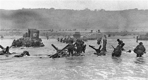 <div class='meta'><div class='origin-logo' data-origin='none'></div><span class='caption-text' data-credit='AP Photo/ IP NC,GP. KEY R3, RE. XMH PDS **'>Some of the first assault troops to hit the Normandy, France beachhead take cover behind enemy obstacles to fire on German forces.</span></div>