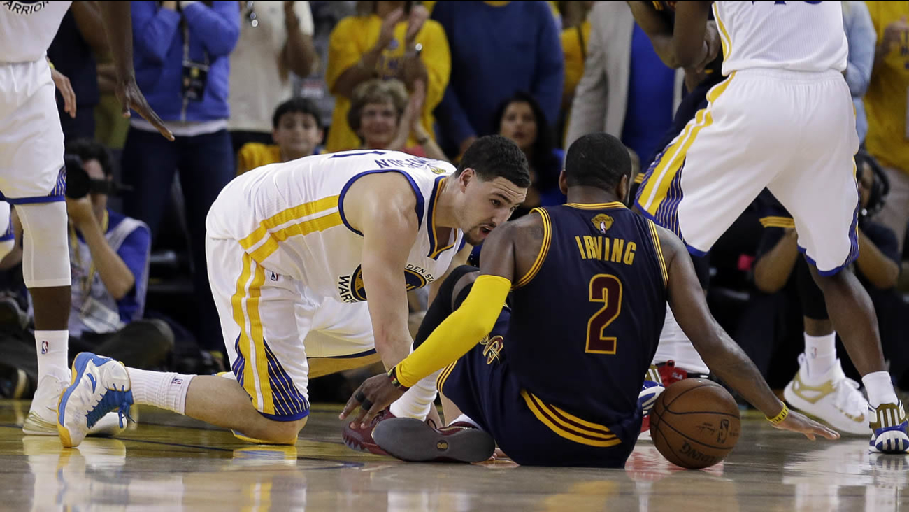 Cleveland Cavaliers guard Kyrie Irving (2) in Game 1 of the NBA Finals in Oakland, Calif., Thursday, June 4, 2015. Irving left the game with an injury right after this play.