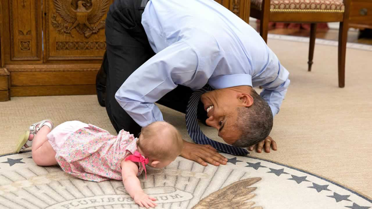 The White House posted this adorable photo on its Facebook page of President Barack Obama playing with the child of one of his staff members on Thursday, June 4, 2015.