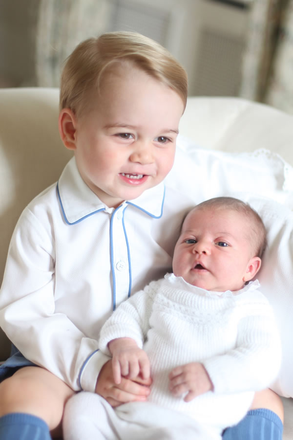 <div class='meta'><div class='origin-logo' data-origin='none'></div><span class='caption-text' data-credit='Duchess of Cambridge via AP'>This image shows Britain's Princess Charlotte, right, being held by her brother, 2-year-old, Prince George.</span></div>
