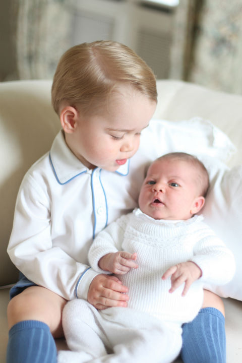 "<div class=""meta image-caption""><div class=""origin-logo origin-image none""><span>none</span></div><span class=""caption-text"">This photo of Britain's Princess Charlotte, held by her brother Prince George, was released by Kensington Palace Saturday, June 6, 2015 (AP Photo/ Duchess of Cambridge)</span></div>"