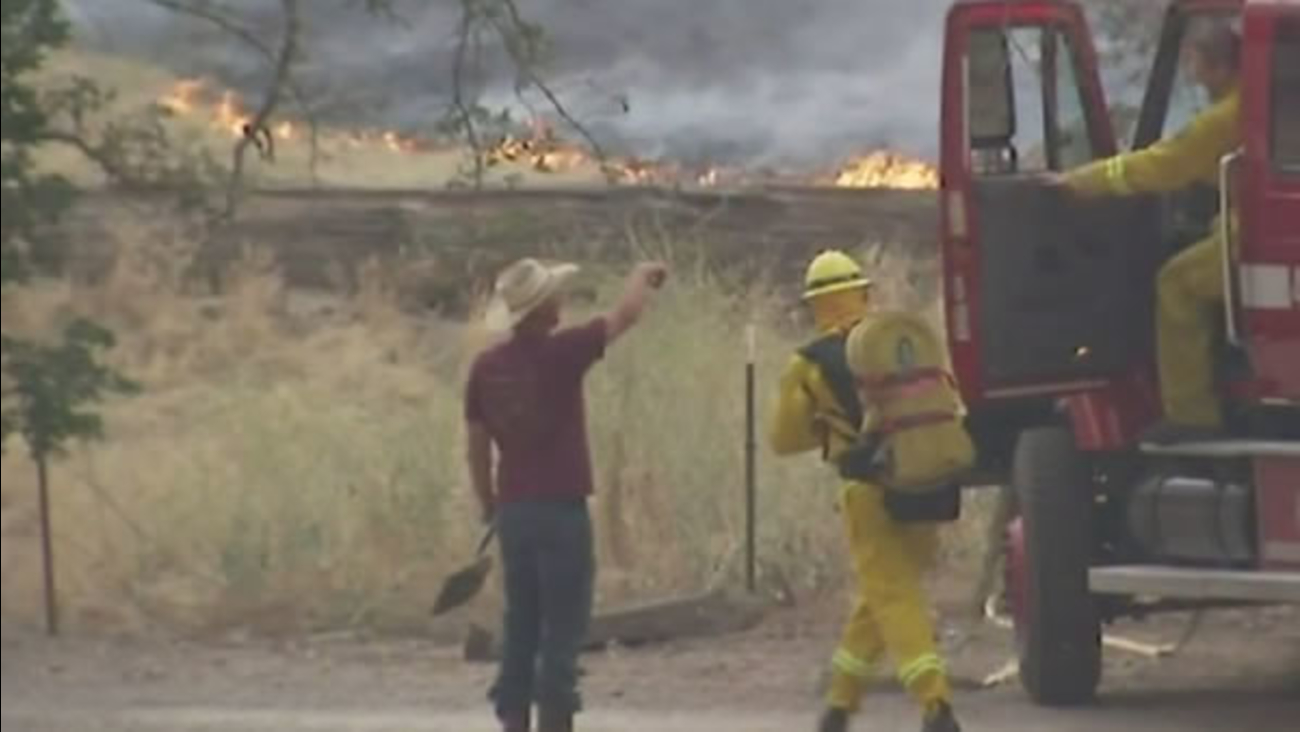 Firefighters battled at least nine wildfires that were sparked by lightning storms in Fresno County on Friday, June 5, 2015.