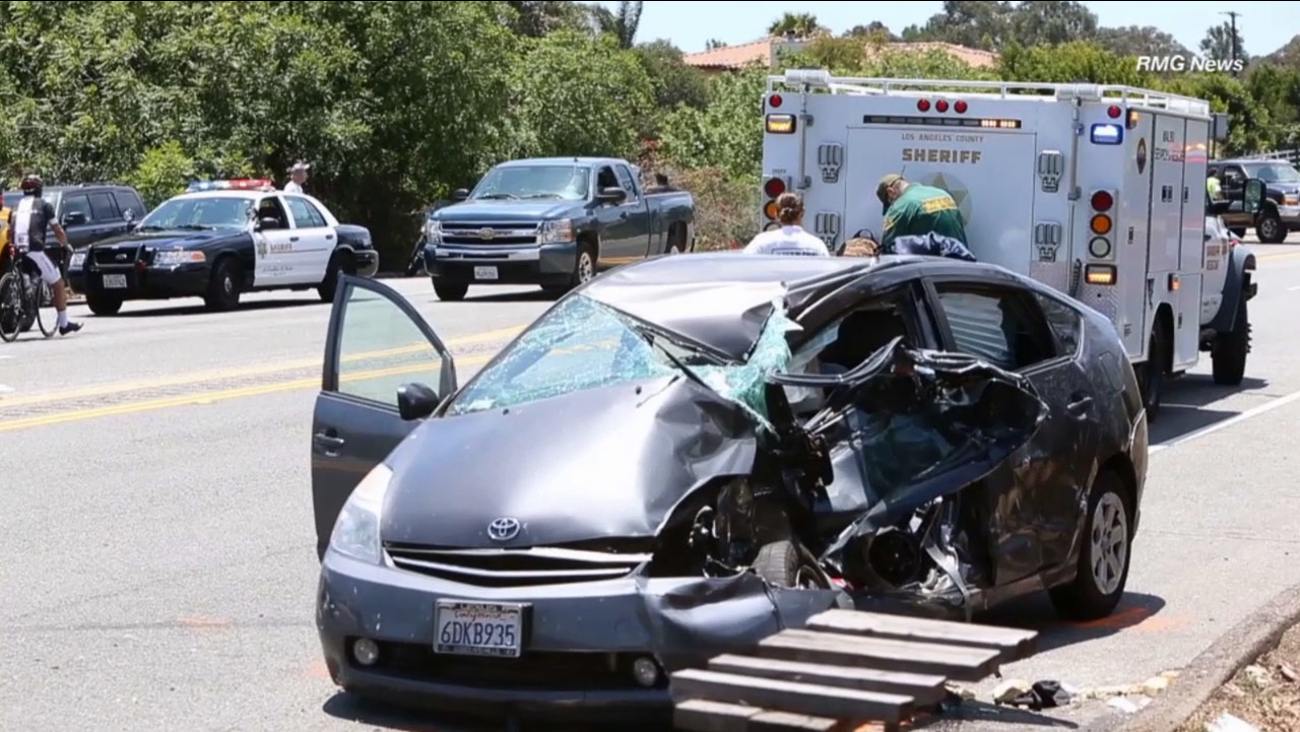 Los Angeles County sheriff's deputies investigate a crash along Pacific Coast Highway in Malibu on Saturday, June 6, 2015.