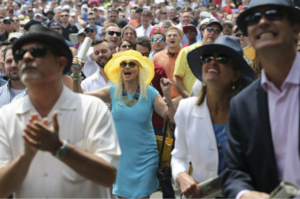 """<div class=""""meta image-caption""""><div class=""""origin-logo origin-image none""""><span>none</span></div><span class=""""caption-text"""">Horse racing fans react while watching a race before the 147th running of the Belmont Stakes horse race at Belmont Park, Saturday, June 6, 2015, in Elmont, N.Y. (AP Photo/ Seth Wenig)</span></div>"""
