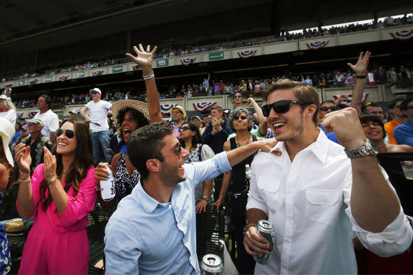 """<div class=""""meta image-caption""""><div class=""""origin-logo origin-image none""""><span>none</span></div><span class=""""caption-text"""">Spectators cheer as horses cross the finish line in the fifth race of the day prior to the 147th running of the Belmont Stakes horse race at Belmont Park (AP Photo/ Jason DeCrow)</span></div>"""