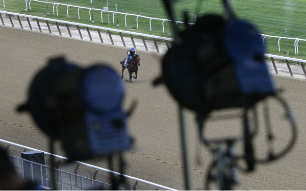 """<div class=""""meta image-caption""""><div class=""""origin-logo origin-image none""""><span>none</span></div><span class=""""caption-text"""">Television broadcast lights hang from the rafters of the grandstand at Belmont Park as Kentucky Derby and Preakness winner American Pharoah. (AP Photo/ Julie Jacobson)</span></div>"""