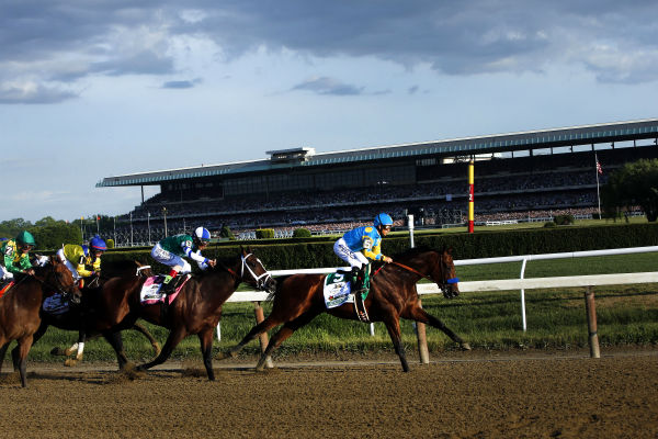 """<div class=""""meta image-caption""""><div class=""""origin-logo origin-image none""""><span>none</span></div><span class=""""caption-text"""">American Pharoah (5) leads the field entering turn three on the way to a Triple Crown victory during the 147th running of the Belmont Stakes horse race at Belmont Park. (AP Photo/ Jason DeCrow)</span></div>"""