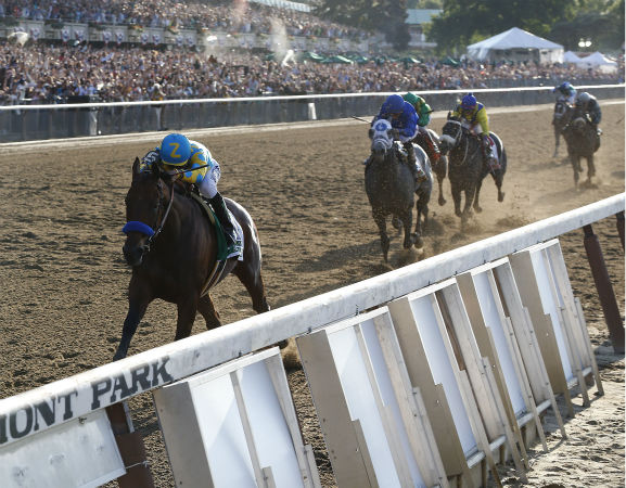 """<div class=""""meta image-caption""""><div class=""""origin-logo origin-image none""""><span>none</span></div><span class=""""caption-text"""">American Pharoah (5) with Victor Espinoza up leads the pack as he approaches the finish line during the 147th running of the Belmont Stakes horse race at Belmont Park (AP Photo/ Julio Cortez)</span></div>"""