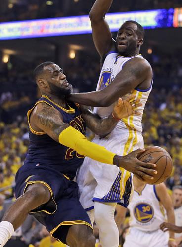 "<div class=""meta image-caption""><div class=""origin-logo origin-image none""><span>none</span></div><span class=""caption-text"">leveland Cavaliers forward LeBron James, left, passes the ball as Golden State Warriors forward Draymond Green defends during the first half of Game 2 of basketball's NBA Finals. (AP Photo/Ben Margot)</span></div>"