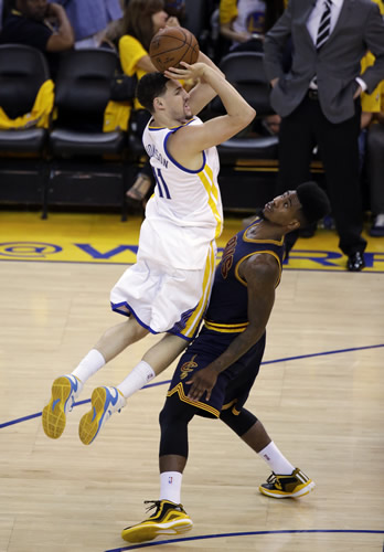 """<div class=""""meta image-caption""""><div class=""""origin-logo origin-image none""""><span>none</span></div><span class=""""caption-text"""">Golden State Warriors guard Klay Thompson (11) loses the ball next to Cleveland Cavaliers guard Iman Shumpert (4) during the second half of Game 2 of basketball's NBA Finals. (AP Photo/Ben Margot)</span></div>"""