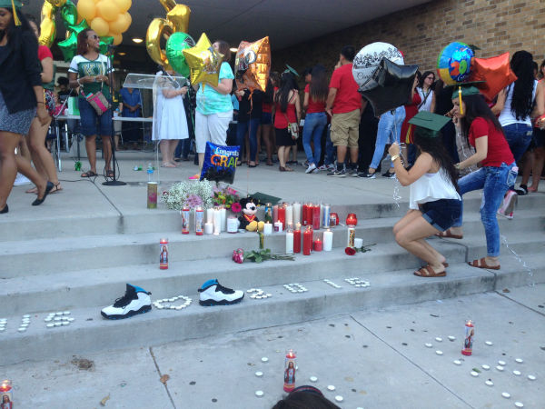 "<div class=""meta image-caption""><div class=""origin-logo origin-image none""><span>none</span></div><span class=""caption-text"">Many attended a vigil held Sunday night for a Klein Forest High School student who died in an accident while on his way to graduation. (Christine Dobbyn/KTRK)</span></div>"