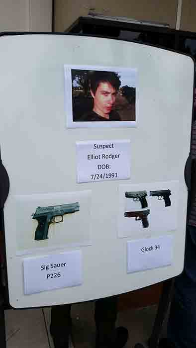 "<div class=""meta image-caption""><div class=""origin-logo origin-image ""><span></span></div><span class=""caption-text"">A board is seen showing the photos of suspected gunman Elliot Rodger and the weapons he used in Friday night's mass shooting that took place in Isla Vista, Calif.</span></div>"