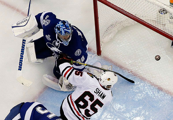 """<div class=""""meta image-caption""""><div class=""""origin-logo origin-image none""""><span>none</span></div><span class=""""caption-text"""">Chicago Blackhawks center Andrew Shaw scores past Tampa Bay Lightning goalie Ben Bishop during the second period in Game 2 of the NHL hockey Stanley Cup Final. (AP Photo/Chris O'Meara)</span></div>"""