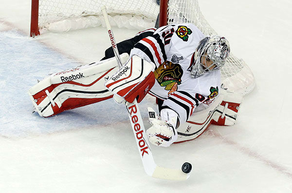 """<div class=""""meta image-caption""""><div class=""""origin-logo origin-image none""""><span>none</span></div><span class=""""caption-text"""">Chicago Blackhawks goalie Corey Crawford makes a save against the Tampa Bay Lightning during the second period in Game 2 of the NHL hockey Stanley Cup Final. (AP Photo/John Raoux)</span></div>"""