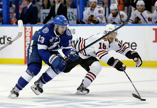 """<div class=""""meta image-caption""""><div class=""""origin-logo origin-image none""""><span>none</span></div><span class=""""caption-text"""">Chicago Blackhawks center Marcus Kruger knocks the puck away from Tampa Bay Lightning center Cedric Paquette during the first period in Game 2 of the NHL hockey Stanley Cup Final. (AP Photo/Chris O'Meara)</span></div>"""