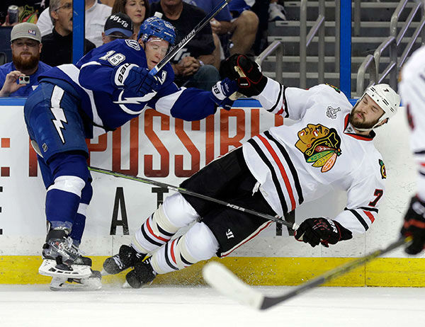 """<div class=""""meta image-caption""""><div class=""""origin-logo origin-image none""""><span>none</span></div><span class=""""caption-text"""">Tampa Bay Lightning left wing Ondrej Palat, left, checks Chicago Blackhawks defenseman Brent Seabrook during the first period in Game 2 of the NHL hockey Stanley Cup Final. (AP Photo/Chris O'Meara)</span></div>"""