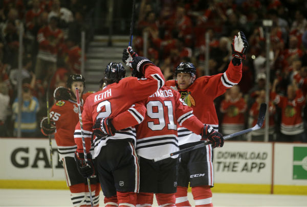 """<div class=""""meta image-caption""""><div class=""""origin-logo origin-image none""""><span>none</span></div><span class=""""caption-text"""">Chicago Blackhawks' Brad Richards is congratulated after scoring during the first period of Game 3 of the Stanley Cup Finals against the Tampa Bay Lightning Monday, June 8, 2015. (AP Photo/ Nam Y. Huh)</span></div>"""