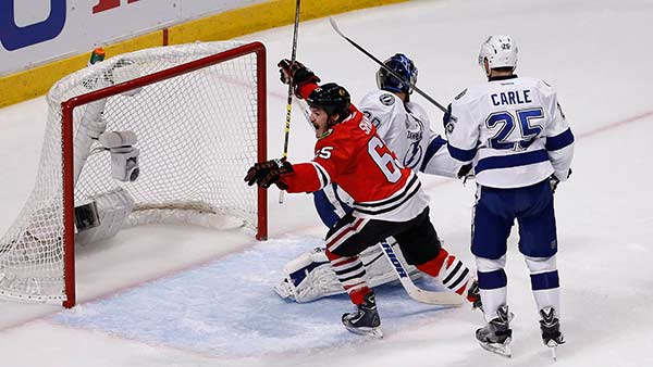 """<div class=""""meta image-caption""""><div class=""""origin-logo origin-image none""""><span>none</span></div><span class=""""caption-text"""">Chicago Blackhawks' Andrew Shaw celebrates after teammate Brad Richards scored in Game 3 of the NHL hockey Stanley Cup Final on Monday, June 8, 2015, in Chicago. (AP Photo/ Charles Rex Arbogast)</span></div>"""