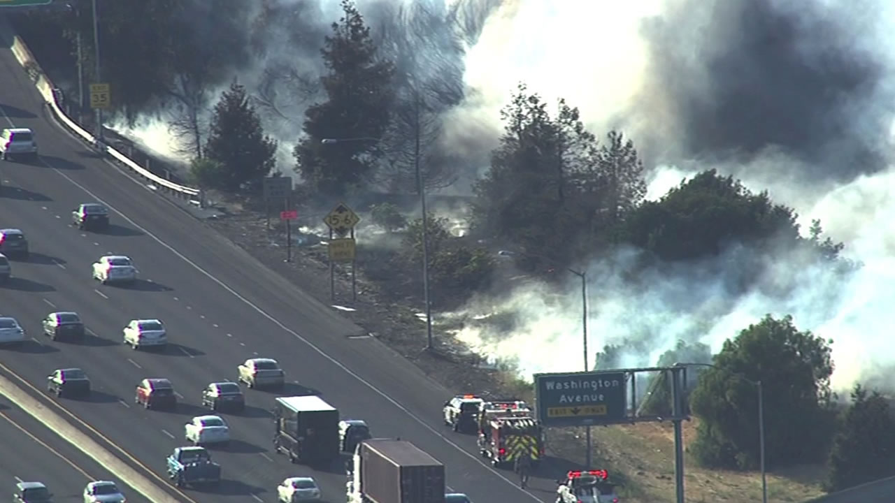 Crews battled a brush fire near Interstates 880 and 238 in Hayward, Calif. on June 8, 2015.