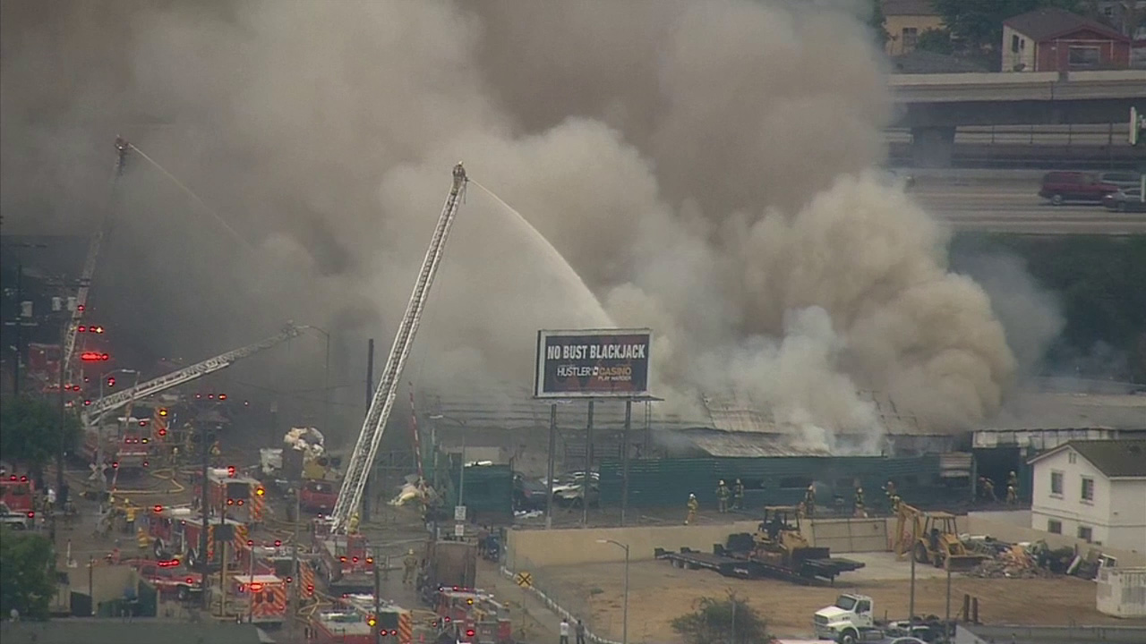 Firefighters battle a structure fire in South Los Angeles near the 105 Freeway on Tuesday, June 9, 2015.