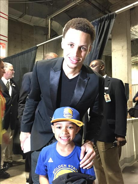 <div class='meta'><div class='origin-logo' data-origin='none'></div><span class='caption-text' data-credit='Photo submitted to KGO-TV by Monica M./uReport'>Noah of Oakland, Calif. was excited to meet Warriors star Steph Curry at Game 1 on his 7th birthday! The MVP was walking by, heard it was his special day, and stopped for a photo.</span></div>