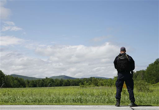 """<div class=""""meta image-caption""""><div class=""""origin-logo origin-image none""""><span>none</span></div><span class=""""caption-text"""">A heavily armed law enforcement officer patrols the edge of road during a search for two escaped killers in Boquet, N.Y., Tuesday, June 9, 2015. (AP Photo/ Seth Wenig)</span></div>"""
