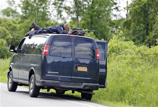 """<div class=""""meta image-caption""""><div class=""""origin-logo origin-image none""""><span>none</span></div><span class=""""caption-text"""">A law enforcement agent looks through a sniper scope during a search for two escaped killers over a field in Boquet, N.Y., Tuesday, June 9, 2015. (AP Photo/ Seth Wenig)</span></div>"""
