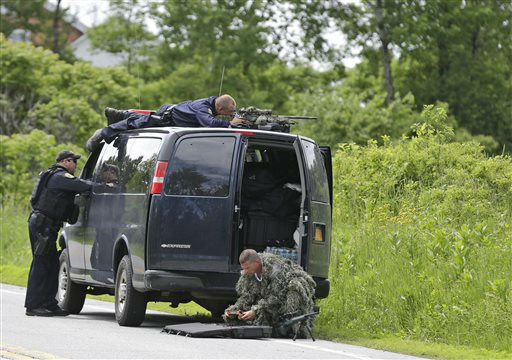 """<div class=""""meta image-caption""""><div class=""""origin-logo origin-image none""""><span>none</span></div><span class=""""caption-text"""">A law enforcement agent looks through a sniper scope while another in camouflage assembles a weapon during a search for two escaped killers in Boquet, N.Y. (AP Photo/ Seth Wenig)</span></div>"""