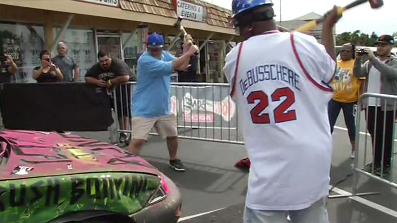 Warriors fans got the chance to smash a Chevy Cavalier as part of a pre-NBA Finals game fundraiser at Rickey's Sports Theatre in San Leandro, June 9, 2015.