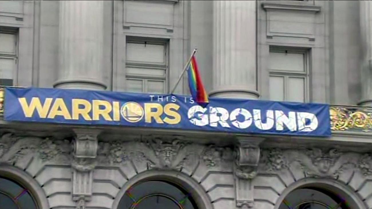 A rainbow flag flies above San Francisco City Hall on June 9, 2015.