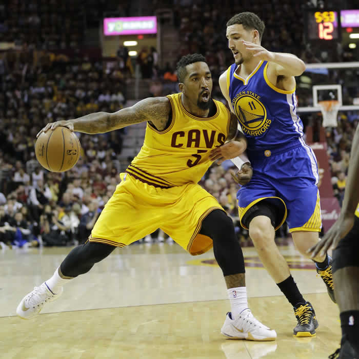 """<div class=""""meta image-caption""""><div class=""""origin-logo origin-image none""""><span>none</span></div><span class=""""caption-text"""">Cavaliers' J.R. Smith drives on Warriors' Klay Thompson during the first half of Game 3 of basketball's NBA Finals in Cleveland, Tuesday, June 9, 2015. (AP Photo/Tony Dejak)</span></div>"""
