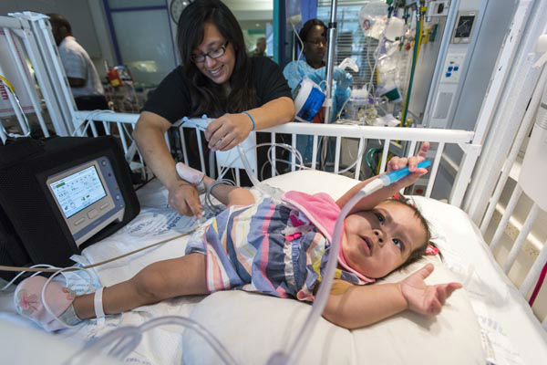 "<div class=""meta image-caption""><div class=""origin-logo origin-image none""><span>none</span></div><span class=""caption-text"">Formerly conjoined twin Adeline Faith Mata has been discharged from Texas Children's Hospital and now joins her sister, Knatalye, at home with her family (Allen S. Kramer/Texas Children's Hospital)</span></div>"