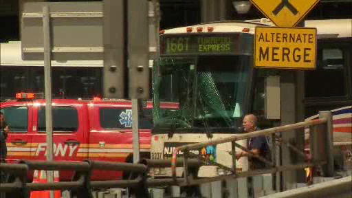 """<div class=""""meta image-caption""""><div class=""""origin-logo origin-image none""""><span>none</span></div><span class=""""caption-text"""">One of the buses involved in the accident is towed from the Lincoln Tunnel.</span></div>"""