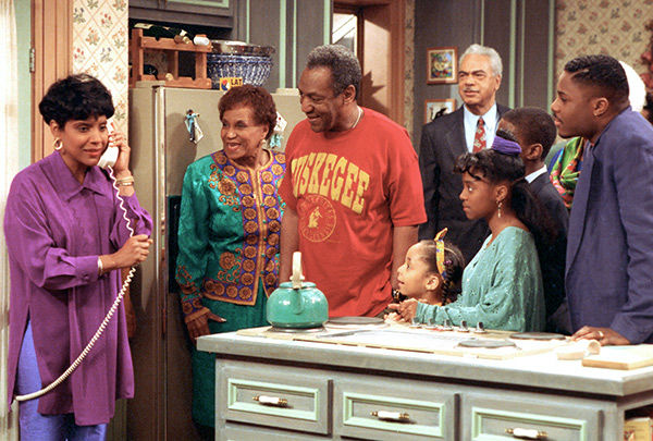 "<div class=""meta image-caption""><div class=""origin-logo origin-image none""><span>none</span></div><span class=""caption-text"">Symone, bottom, appears as Olivia on ''The Cosby Show'' with the cast in 1992. (AP)</span></div>"