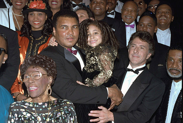 "<div class=""meta image-caption""><div class=""origin-logo origin-image none""><span>none</span></div><span class=""caption-text"">Symone attends Muhammad Ali's birthday party in 1992 with Ali (center), Ella Fitzgerald (left) and Dustin Hoffman (right). (AP Photo/CHRIS MARTINEZ)</span></div>"