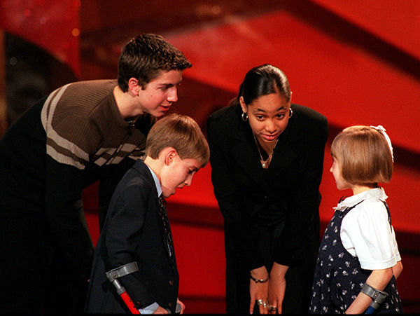 "<div class=""meta image-caption""><div class=""origin-logo origin-image none""><span>none</span></div><span class=""caption-text"">Symone appears at a charity event in 1999. (AP Photo/JOHN HAYES)</span></div>"