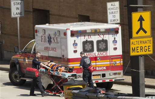 """<div class=""""meta image-caption""""><div class=""""origin-logo origin-image none""""><span>none</span></div><span class=""""caption-text"""">An injured person is carried on a stretcher to an ambulance at the entrance to the Lincoln Tunnel. (AP Photo/ Mark Lennihan)</span></div>"""